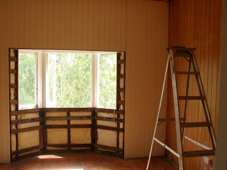 repannelling and painting of cottage walls