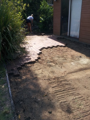 removing pavers from around house and garage
